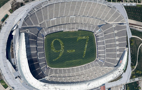Satellite image reveals hidden message in stadium turf. Is it a message to their alien masters? We may never know...